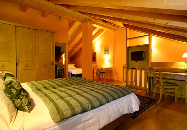 A typical bedroom within the Hotel Boton D'or