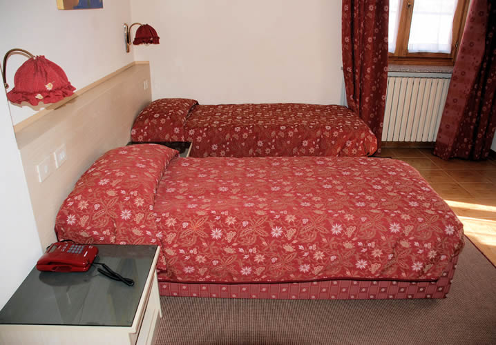 A typical bedroom within the Hotel Beau Sejour