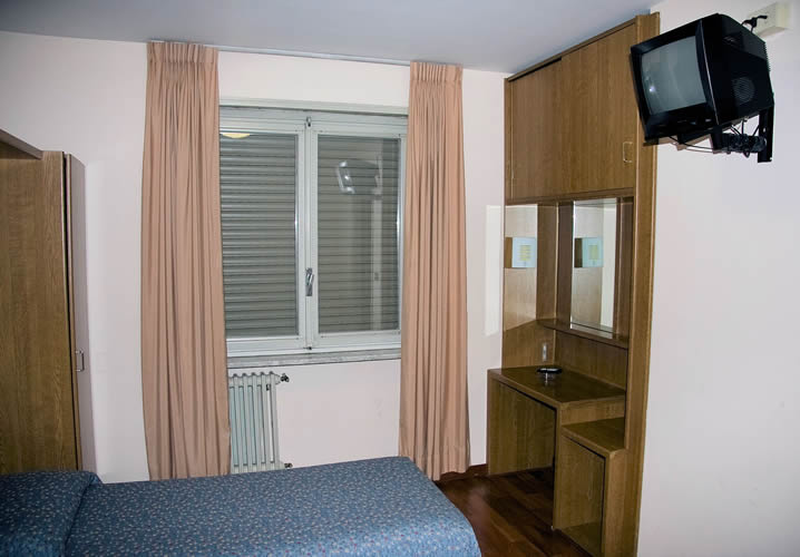 A typical bedroom in the Hotel Roma