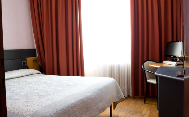 A typical double bedroom in the Hotel Turin
